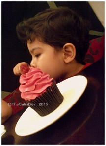 Advait digging into his cupcake